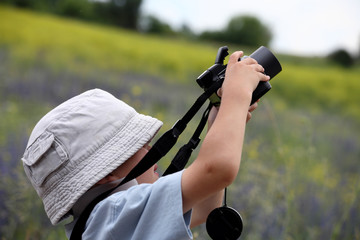 Child already practicing with camera shooting pictures of nature