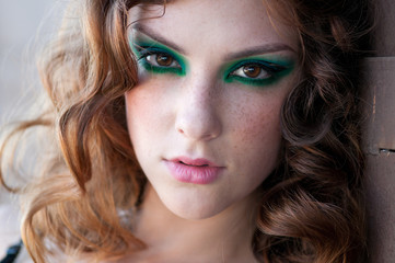 Fashion woman with green make-up at rural location