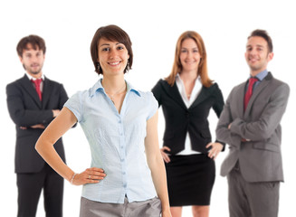 Beautiful smiling businesswoman smiling in front of her team