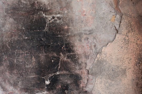 Close up of a  wall with soot and fire damages