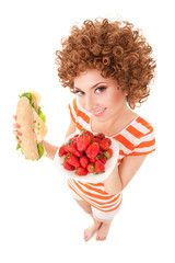 Fun woman with strawberry and sandwich on the white background