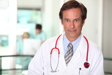 Doctor in a white coat and stethoscope