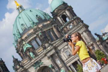 young girl with photo camera
