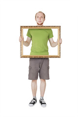 man in green shirt holding decorative picture frame, isolated