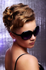 Young woman wearing sunglasses.