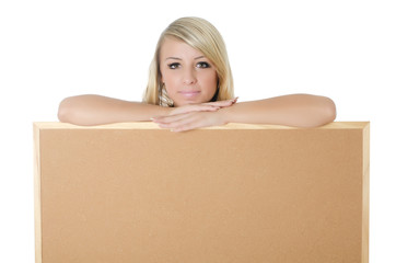 Woman holding a blank corkboard