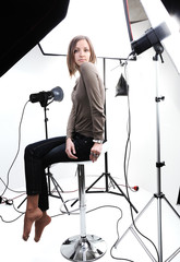 Young beautiful model posing in professionally equipped studio