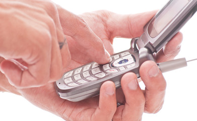 Hands Dialing on Phone Key Pad