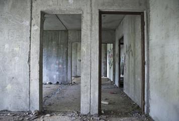 Inside gray abandoned concrete house