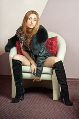 Seductive young girl in a chair