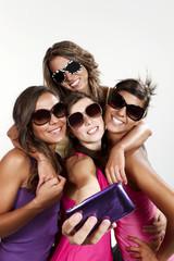 four girls take a self portrait