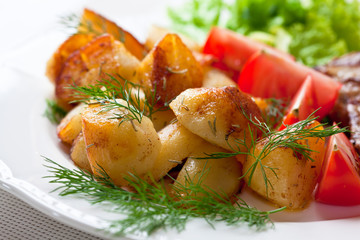 Roasted potatoes with fresh dill and tomatoes