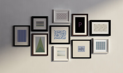 Wall with black and white frames and canvas