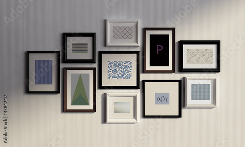 Wall with black and white frames and canvas\