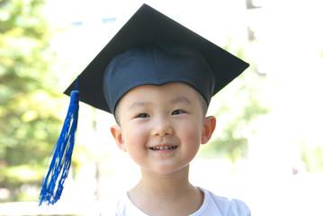 Asian child wear gown hat