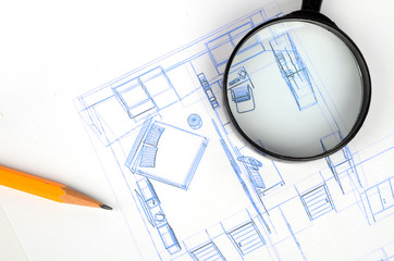 Pencil,magnifier and house plan