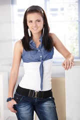 Pretty girl in jeans and blouse smiling