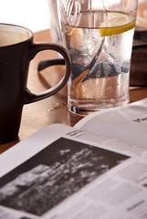 Reading newspaper in cafe during break