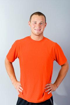 Handsome man in an orange shirt