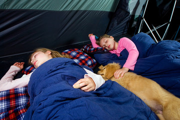 kids sleeping in a tent