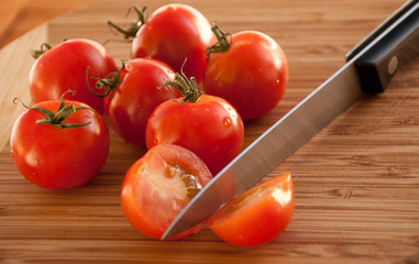 Red tomato with the knife