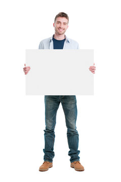 Happy guy holding placard
