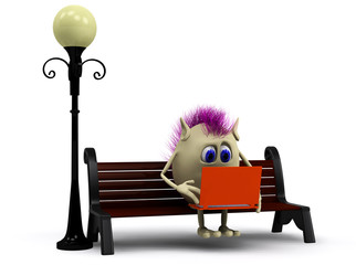Haired puppet using orange laptop on bench