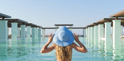 Beautiful woman look forward near pool