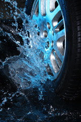 Car's wheel  with blue water