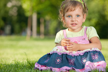 Pretty little girl in the park