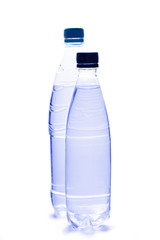 Plastic bottles of water on white background