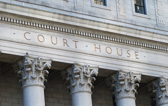 The words Court House outside the Supreme Court