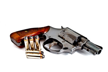 Revolver hand gun with bullets, studio shot