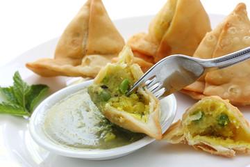 potato samosa with fresh mint dipping sauce , indian food