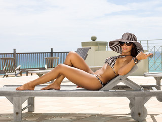 Attractive Woman Sunbathing on Lounge Chair