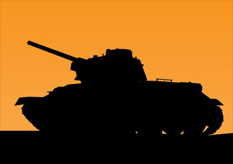 tank silhouette against the background of orange sunset