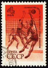 Volleyball competition on post stamp