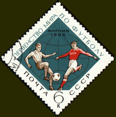 Football players on post stamp