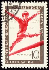 Post stamp shows female gymnast on balance beam