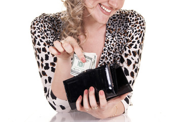 Smiling woman holding purse with cash