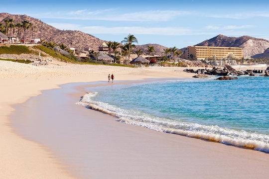 Couple walking on beach in Cabo San Lucas, Mexico