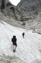 Crossing of snow field in Julian Alps