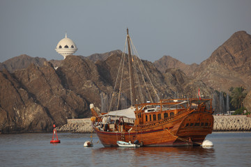 Old wooden ship in the harbor of Muscat, Oman