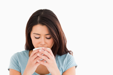 Good looking woman enjoying a cup of coffee