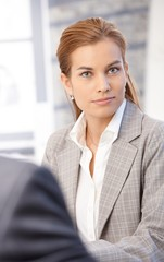 Attractive businesswoman sitting in office