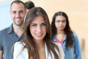 Portrait of student standing in front of group