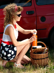 Girl on the picnic with basket and thermos