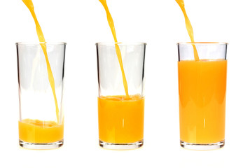 Pouring orange juice into the glass
