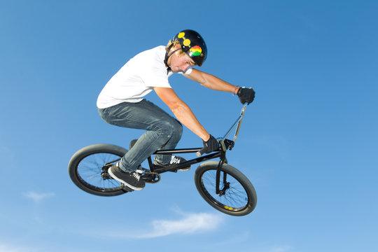 Freestyle BMX rider getting air