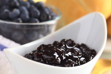 Blueberry jam with fresh blueberries and buns